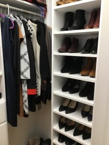 Closet built by Closets, etc. for an Angie's List customer that includes a shoe rack on the right and wardrobe space on the left.