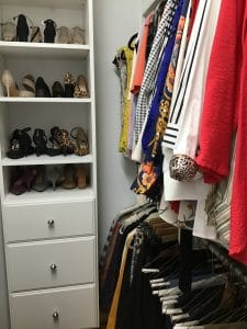 Closet built by Closets, etc. for an Angie's List customer that includes a white shoe rack and drawers on the left on the right and wardrobe space on the right.