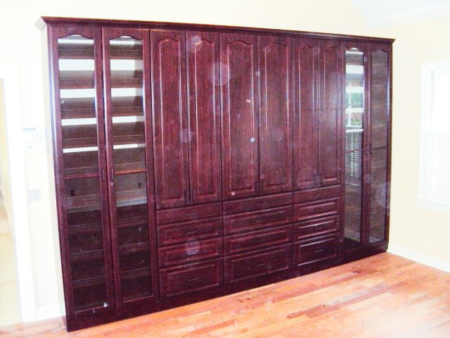 Full Wall Unit With Mahogany Raised Glass And Panel Crown Molding